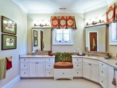 Storage space is not an issue in this white traditional bathroom. White double vanities provide ample space for towels, cleaning products and other accessories.