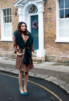 30 ways to add color to your winter outfits - faux fur emerald green stole, green pointy-toe heels