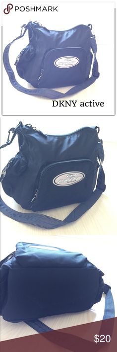 DKNY active Shoulder Bag Good condition Bag with wide base. Slight fray at strap as shown in photo. Dkny Bags Shoulder Bags