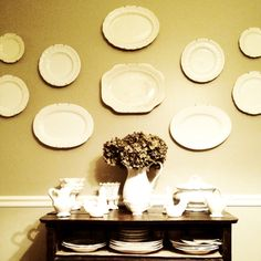 Vintage white platters and plates as a wall display. Pretty!