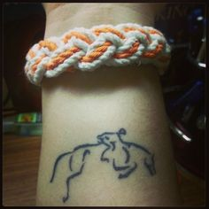 nice and small equestrian tattoo