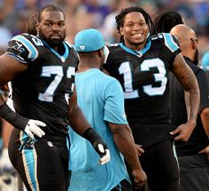 Carolina Panthers wide receiver Kelvin Benjamin, right, smiles as he talks with…