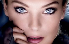 """for blue eyes - pink or peach eye shadow accentuates the blue in your eyes. Pink or peach all over the lid; add a darker color to the crease. If you want a darker shade, bronze is considered the """"universal"""" eye shadow color for blue eyes because it is akin to orange, which is opposite from blue on the color wheel."""