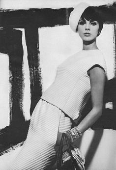 September Vogue 1964  by Richard Avedon    Wearing a white-on-white wool and dacron outfit by Donald Brooks.