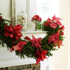 Attach poinsettias to a plain garland.  Complement with red, silver, and off-white ornaments