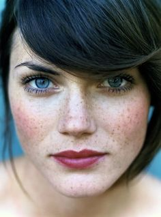 dark hair blue eyes woman and those cute frekles