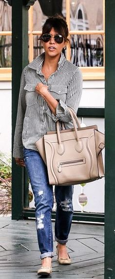 Kourtney Kardashian Casual Style Contains A Black And White, Stripped, Button Up Shirt; Ripped Jean Capris; And Nude Flats And Purse.