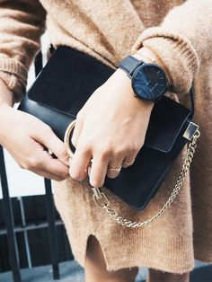 small black crossbody flap bag | Chloe Faye | suede flap | large metal ring & chain | vintage retro | + | tan/camel long sweater dress | soft, oversized | black face large watch | minimal | casual chic street style