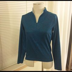 Nike fit dry running jacket Fun pattern! Fit dry running jacket, hi-low style with no-ride edging on back of bottom. Flattering fit. Size M. (Very slight staining on inside of back, cannot see when wearing) Nike Jackets & Coats