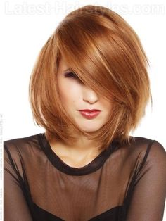 Layered medium length bob haircut for spring ---- exept I won't wear my hair all in my face like that ;)