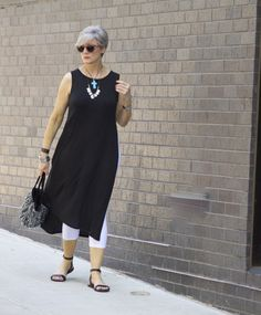Beth from @bdjalali layers her J.Jill Wearever lightweight long tunic over her J.Jill capri leggings and accessorizes with her J.Jill Born Stephane sandals and her J.Jill beaded medallion necklace.
