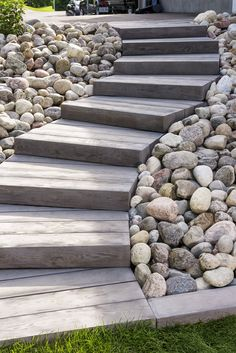 Love the look of wood planks for your deck or patio but don't want the maintenance? Our Borealis patio slabs look & feel like wood but are made of concrete paving slabs! Outdoor Steps, Patio Steps, Outdoor Landscaping, Backyard Patio, Stone Landscaping, Wooded Backyard Landscape, Steep Hillside Landscaping, Outdoor Pavers, Landscaping Ideas