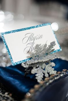 Glitz and Glam! Love these sparkly snowflakes as place card holders {Carmen Salazar Photography}