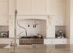 Villa Homes design traditional English-style kitchens that combine character with modern functionality.