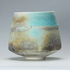 This is a thrown and altered porcelain bowl by Jack Doherty that he has soda fired in a gas kiln.