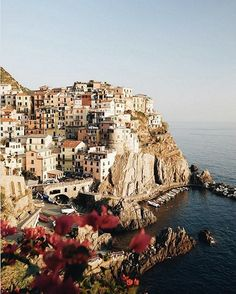 If this view looks familiar, it's because it is. The petite pastel village of Manarola in CInque Terre, Italy is one of the most photographed places in the world.