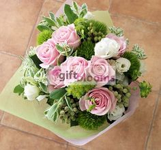 Bouquet of pink roses with assorted flowers