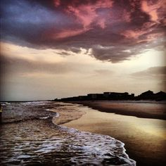 Walking down the beach along the South Carolina coast, the evening is cool and the surf gentle under a red sky.  My feet are wet.