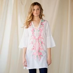"""FLOURISHES AND FLOWERS TUNIC--Pure prettiness to pop over your swimsuit, shorts or jeans. Breezeweight cotton lavished with embroidery laces up the front and finishes with flared sleeves. Side vents. Dry clean. Imported. Sizes S (2 to 4), M (6 to 8), L (10 to 12). 30-1/2""""L."""
