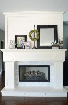 love it all: plank wall above mantel, mini marble subway tile surround, trim work