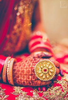 Woah! Love this bridal statement ring. Even the henna or mehndi looks amazing.