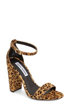Crushing on these fierce, minimalist ankle-strap sandals. They're set on a chunky heel and covered in a lush leopard pattern.