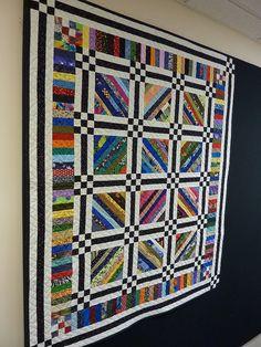 Strip Quilt by Nettie's Quilts, via Flickr