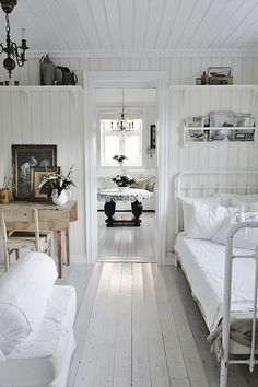 White bed linens. Antique furniture.