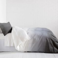 Crazy for ombre. Chic yet beautifully simple, the Ombre Duvet Cover and Sham Set features a soothing fade from white to charcoal grey, or from grey to white, depending how you flip it!. This crisp, 100% cotton, 250-thread count, duvet works as a blank canvas, allowing you to pair any accessories to complete the look. With a built-in hidden zippered closure for easy bed making, this cool duvet set is long lasting and luxurious. Master the art of simplicity with this ombre bedding. Set…