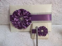 Ivory Satin Wedding Guest Book with Amethyst Purple Flower and Rhinestone Mesh Trim & Pen Set via Etsy