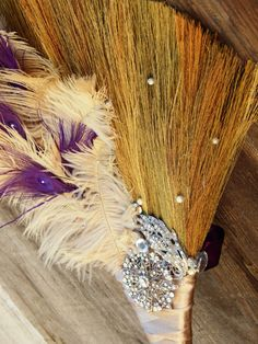 Ostrich and purple peacock feather wedding jumping broom. Wedding brooms are used in African, African American, Celtic wedding ceremonies to name a few #tradition #culture #Jumpingthebroom #loveisuniversal