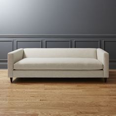 Shop movie birch sofa.   Deep down lounge invites curling up for a double feature.  You don't sit on it, you sit in it—if you get the difference.  Pile on too many pillows and stretch out.  Linen poly-weave lounges lush.