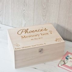 A perfect way to keep all those precious memories safe The box has two handles on the side and a strapped lid with hinges to open up The box is
