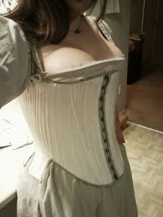 Great blog entry about how she made this.  I'd love to know (having never made a reeded corset) how much larger she cut the pattern to make up for the way the fabric would draw up once the channels are stuffed. (The Tudor Revolution: Effigy Corset with Reeds)