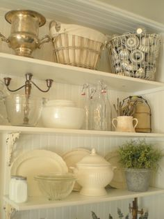 open shelving.  I pinned this for the sole purpose of reminding myself to find a wire basket for all my old cookie cutters.