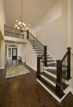 Oak Forest Home Ready For Move-In - 3,386 Sq. Ft. - Foyer & Grand Staircase - #PerryHomes #trustedbuilder #OakForest #HoustonHeights #TheHeights #HoustonHomes #realestate #relocatingtohouston #houstonenergycorridor #openconcept #openfloorplan #interiordesign #homebuilding #homebuying #summersalesevent #foyer #hallway #grandstaircase #staircase #woodstairs #woodfloor