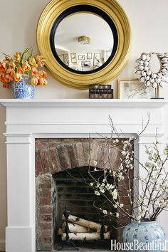 Birch Logs Benjamin Moore's White Dove — one of the most popular paint colors — on a custom mantel updates the brick fireplace in a historic Georgetown rowhouse. The bull's ­eye mirror by Carvers' Guild seemingly enlarges the space, while birch logs and flowering branches bring in natural textures. See more cozy fireplace ideas at HouseBeautiful.com.