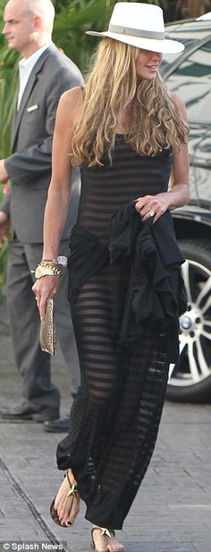 Sheer bliss! Beaming Elle Macpherson sports a see-through dress as she's…