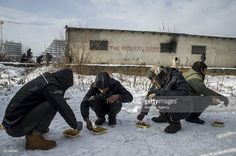 Refugees eat their foods distributed by Hot Food Idomeni outside a derelict warehouse where they took shelter in Belgrade, Serbia on January 12, 2017. Hot Food Idomeni is a non-political group providing humanitarian aid and collaboration and coordination with NGOs and organisations, including MSF, UNHCR, etc. Despite the help of local and international organisations, the situation in the warehouses have been very precarious for months, waiting on borders to open. Refugees mostly coming from…