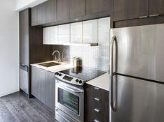 AyA Kitchens | Canadian Kitchen and Bath Cabinetry Manufacturer | Kitchen Design Professionals - Tribeca Serra and Zenith White in Urban Moda