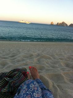 Relaxing on the Beach with a nice view of Lands End in Cabo San Lucas, Mexico