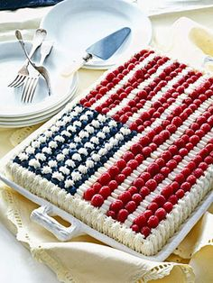 Bake this cake for a star-spangled 4th of July celebration. Use blueberries, raspberries, and frosting to create a flag on top of the lemony sponge cake.