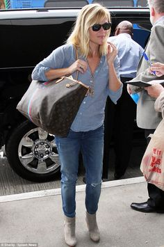 Personalised: Reese toted a monogrammed Louis Vuitton tote which had the initials L.R.W, which stands for Laura Jeanne Reese Witherspoon, her real name