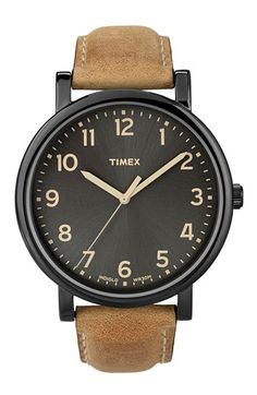 "Timex ""Easy Reader"". Nice, simple black face on a distressed brown strap. $60 at Nordstrom (via Amazon)."