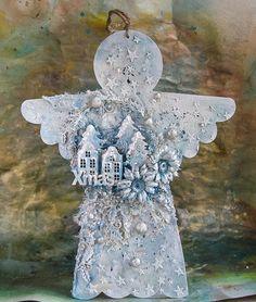 Do zrobienia mojego anioła użyłam bazy ze sklejki,   którę najpierw pomalowałam dwukrotnie gesso.       Następnie przez maskę nałożyłam h...