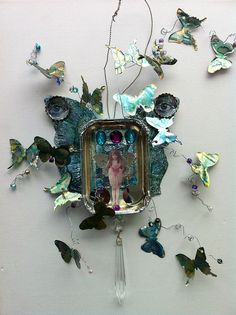 THE BUTTERFLY EFFECT A altered sardine can with the butterflies cut from lids with a SIZZIX BIG SHOT and movers and shapers die.Ranger alcohol inks were used to colour the tin and butterflies.
