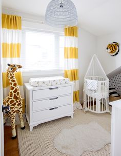 For son Leo's nursery, designer Jillian Harris chose striped white and yellow drapes for a bold, yet cheery statement. | Photographer: Janis Nicolay
