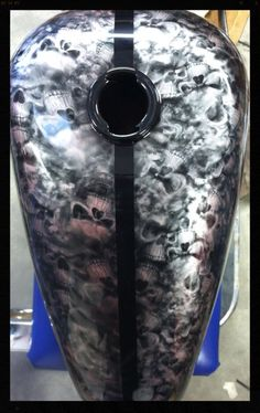 Motorcycle tank customized with Hydrographics in Reaper Skulls pattern and custom chameleon paint/design.  Find us on Facebook /alexandersgeneralstore.