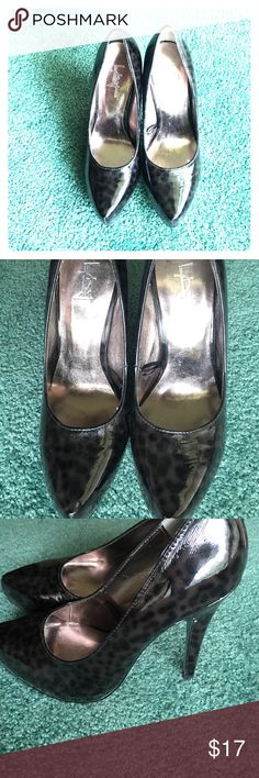 Size 7 heels. Size 7 heels. Black and grey leopard pattern. Very stylish Shoes