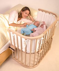 Babybay Maxi Bedside Cot: The BabyBay Maxi Cot features a wider base and is ideal for twins or babies who need a little more space.